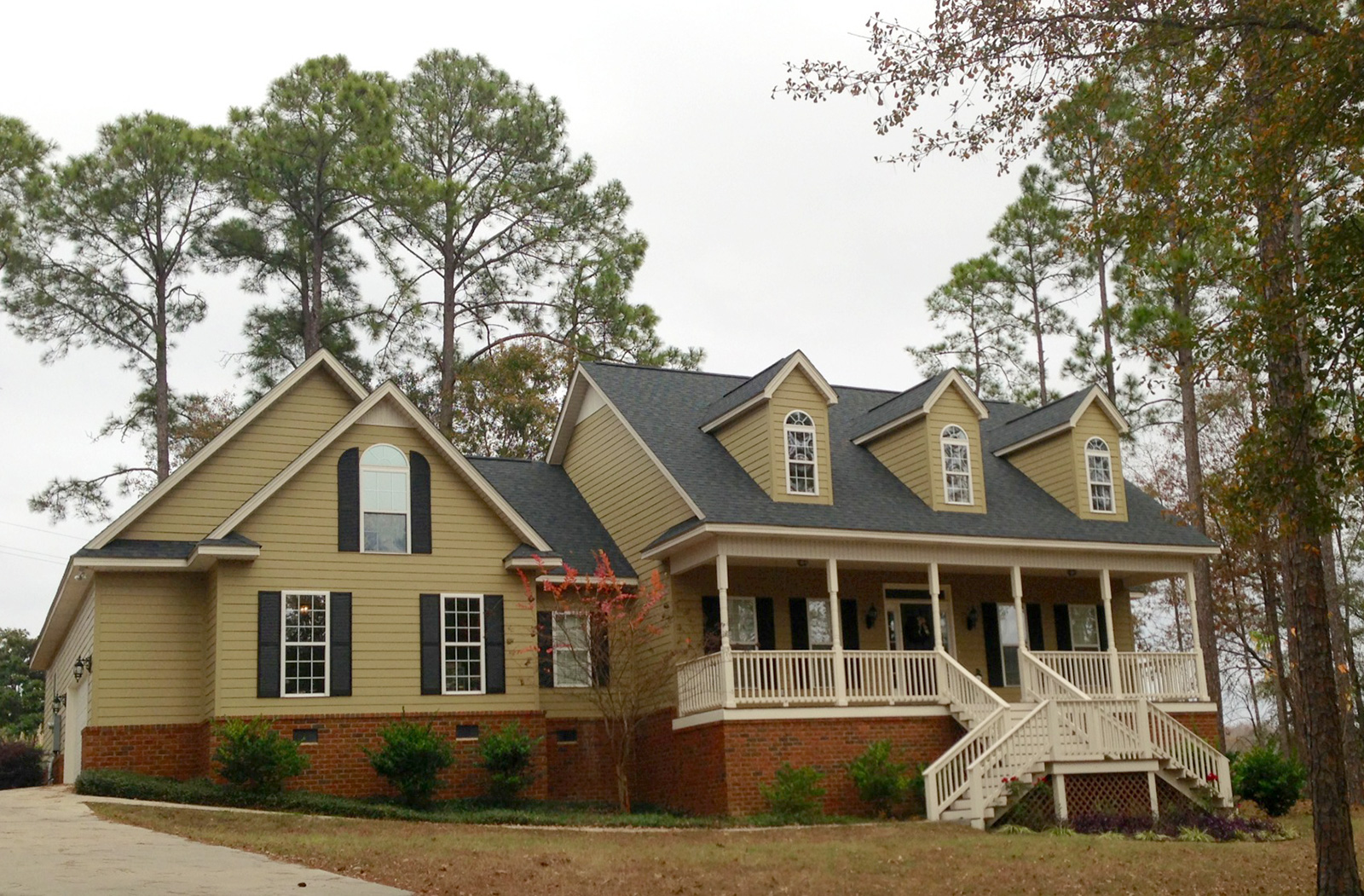 Rain gutter solutions american roofing vinyl siding sc ga nc tn mo for All american exterior solutions